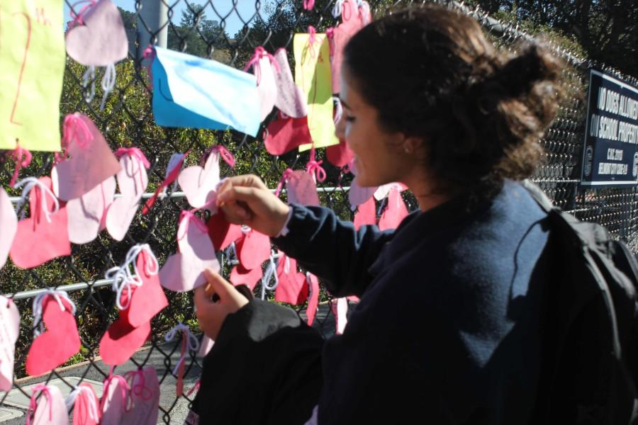 Students find their hearts on ASB's wall of hearts.