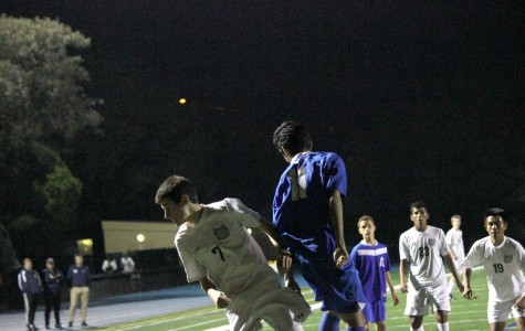 While playing striker, sophomore Leo McBride leaps into the air and beats his opponent to the ball as he heads it away from pressure.