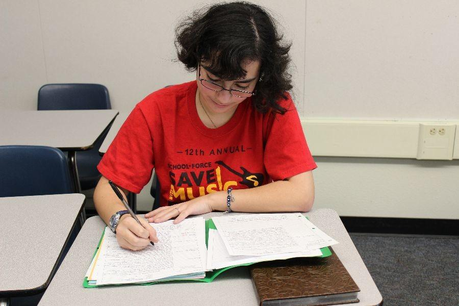 Junior Rebecca Medina takes good notes to help her graduate a year early.