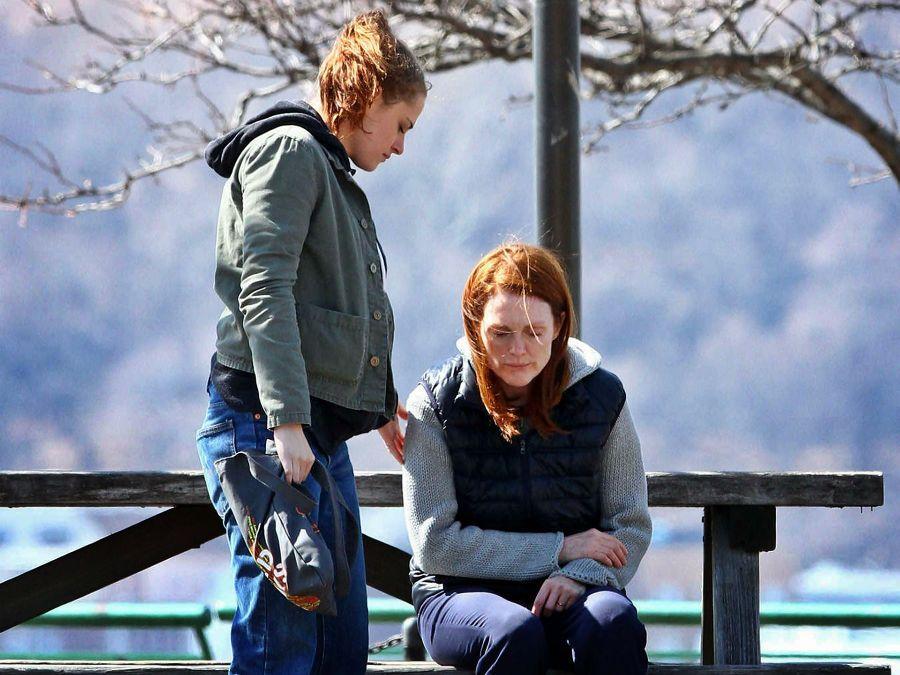 Lydia Howland (Kristen Stewart) helps her Alzheimer's-ridden mother off a park bench. Alice Howland (Julianne Moore) is hardly responsive; she bears a cross she deserves not.
