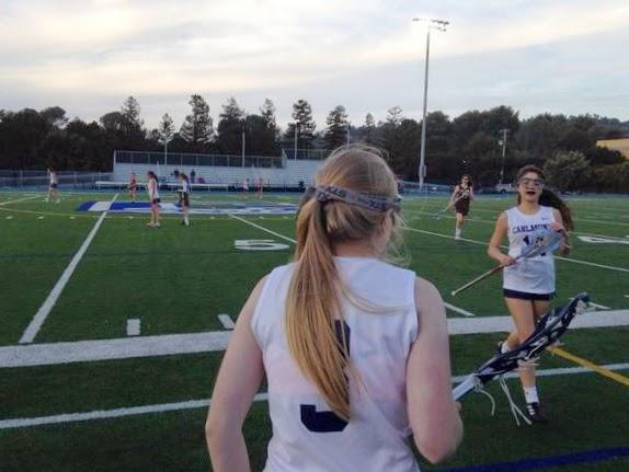 Juniors Abbey Holbrook and Megan Wilson rotate in a 2014 season game against Saint Francis High School.