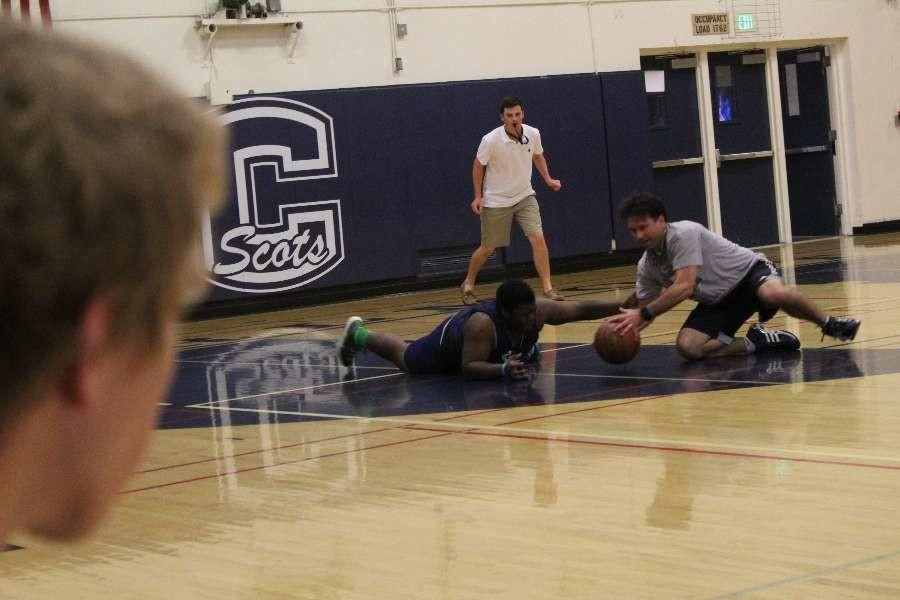 Ralph Crame, Instructional Vice President and senior went to the floor fighting for a ball during the senior versus staff game.