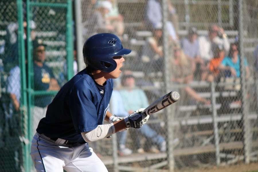 Left fielder Tyler Brandenburg, a junior, sets his stance low as he prepares to bunt the ball to advance Carlmont's base runners.