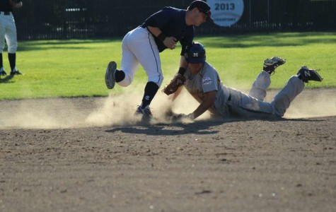 Second baseman Aaron Albaum sweeps across the base as he attempts to tag out Menlo's baserunner stealing second base.