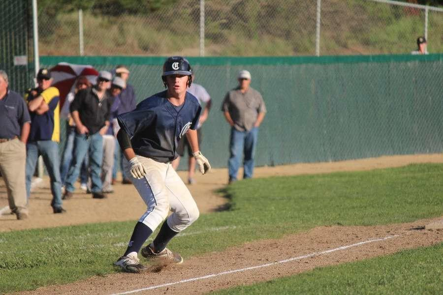 Center fielder Spencer Stewart, a junior, rounds third base during a two out rally, in which Carlmont scores to even the score.