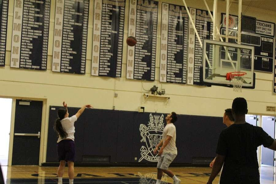 Alonso shot three pointer during the junior versus sophomore game.