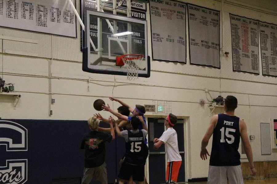 Freshmen and seniors struggling for a ball.