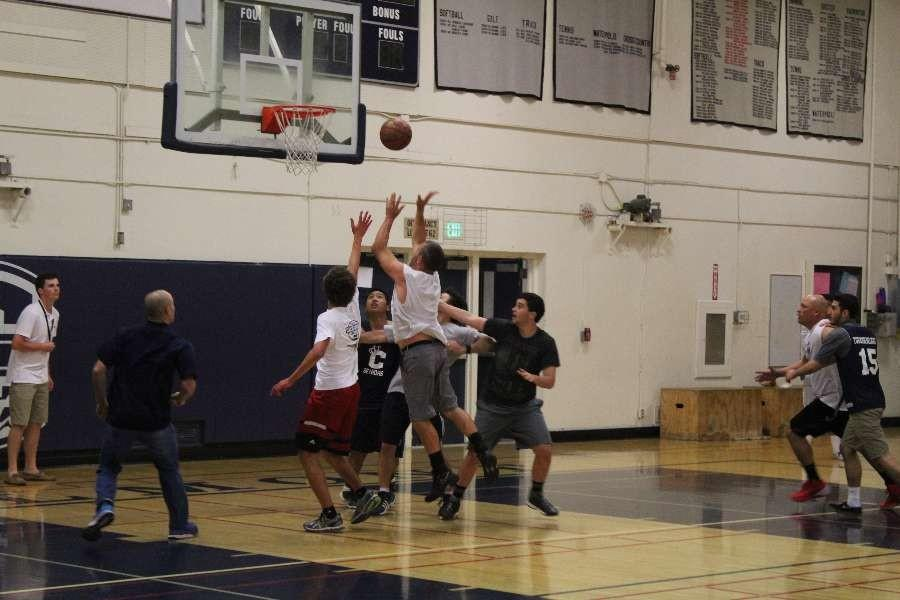 Staff and seniors struggle for the ball.
