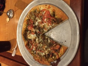 Waterfront's Mid-East Pizza is topped with mozzarella, feta-cheese, tomatoes, and zatar which all contribute to a savory taste.