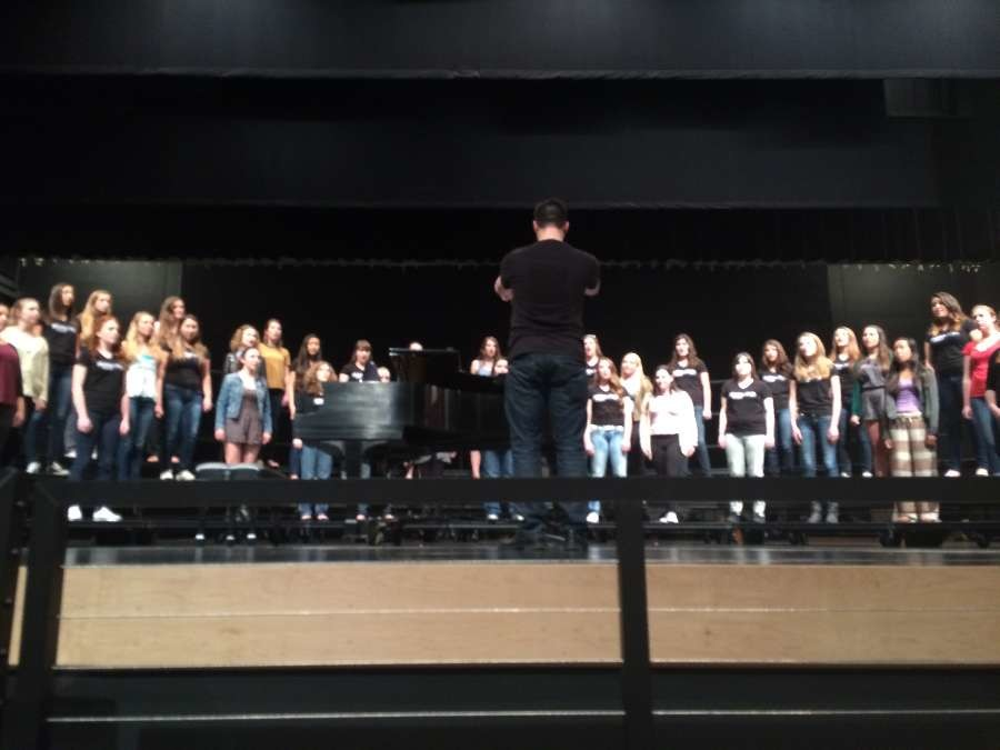 Shasta%27s+choir+director%2C+Gavin+Spencer%2C+conducted+the+Shasta+Women%27s+Choir+and+the+former+Carlmont+Treble+Clef+choir+as+they+performed+%22Famine+Song.%22