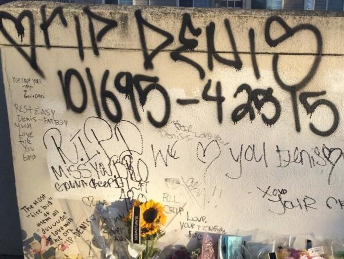 Meshchyshyn's friends and family write heartfelt messages on the wall of the parking lot where he was stabbed.