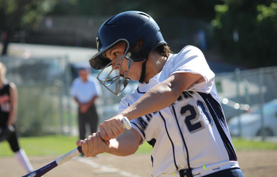 Allison Chavez, a sophomore, keeps her head down and focuses on the incoming pitch as she rotates her hips and begins her swing.