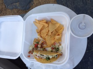 Nikko's tacos come with a large side of chips and different dips.