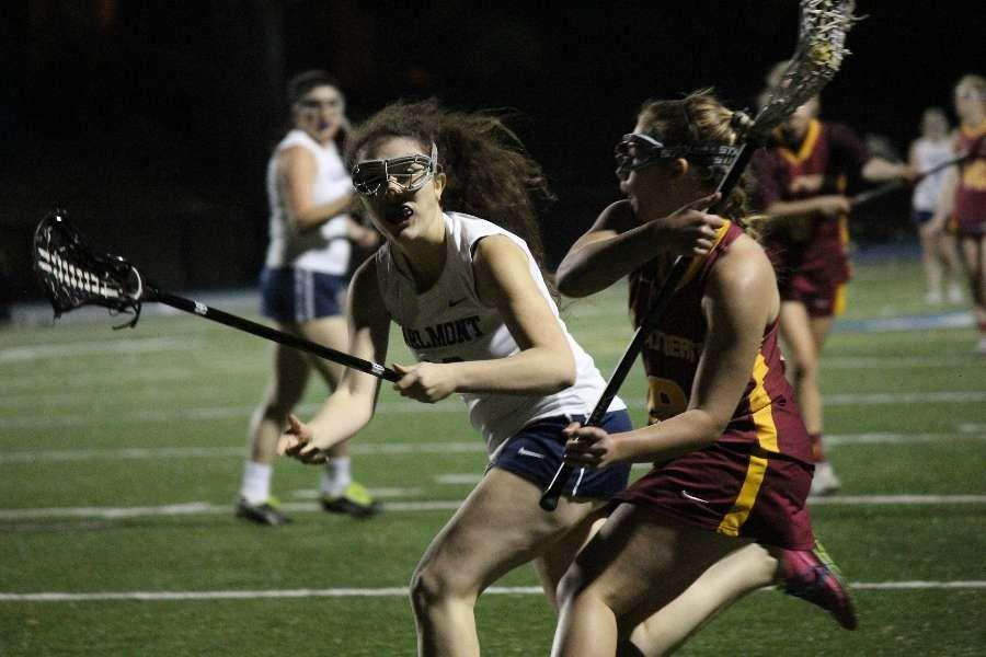 Sonia Paulo, a senior, defends her opponent tightly as she closes in to cut off the Meno-Atherton attacker's run.