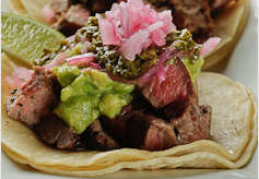 Steak tacos featured on Milagros menu.