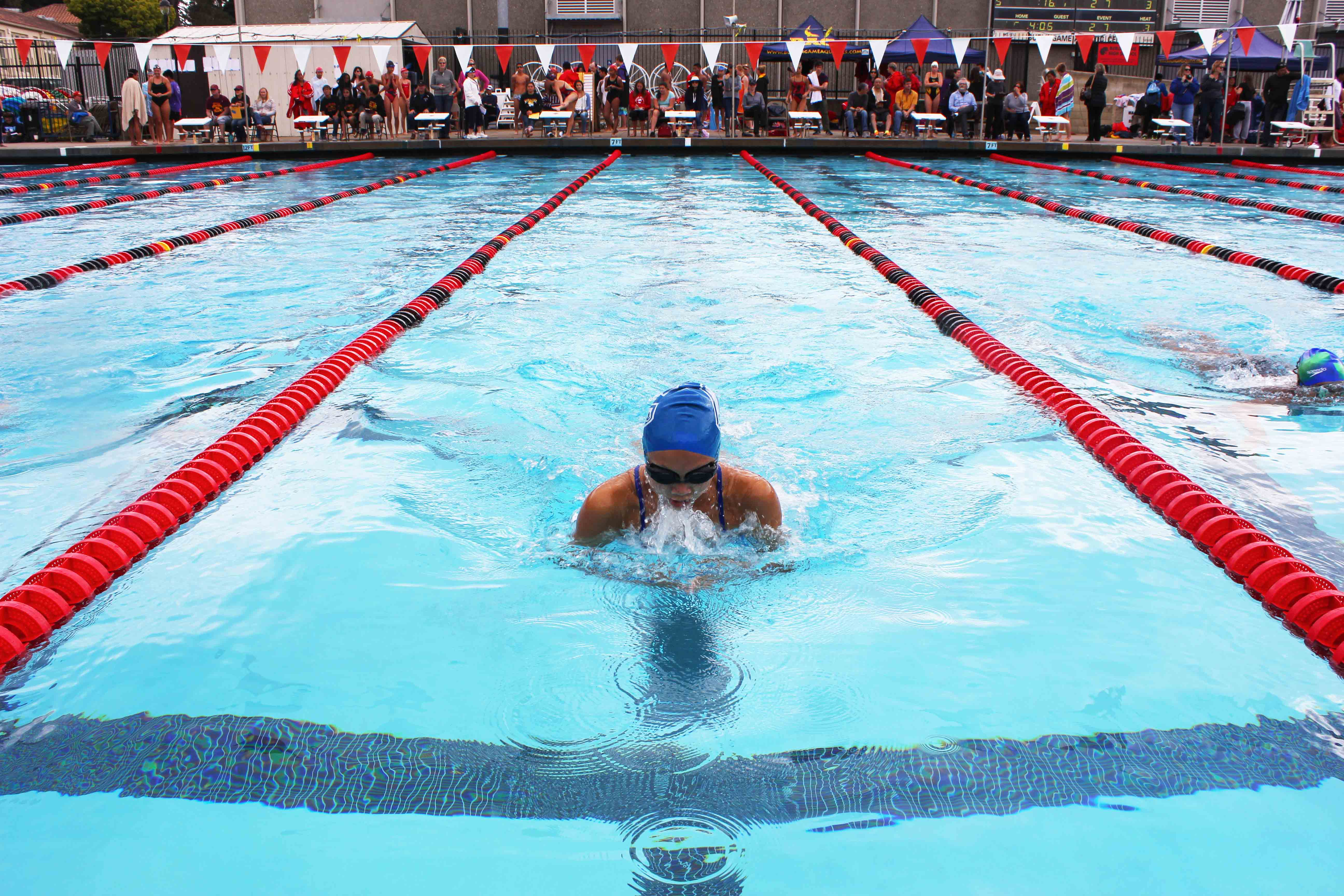 Freshman Tiffany Chung swims her breaststroke event.