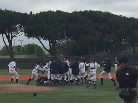 Carlmont tackles each other after Bologna hits the game winning RBI.