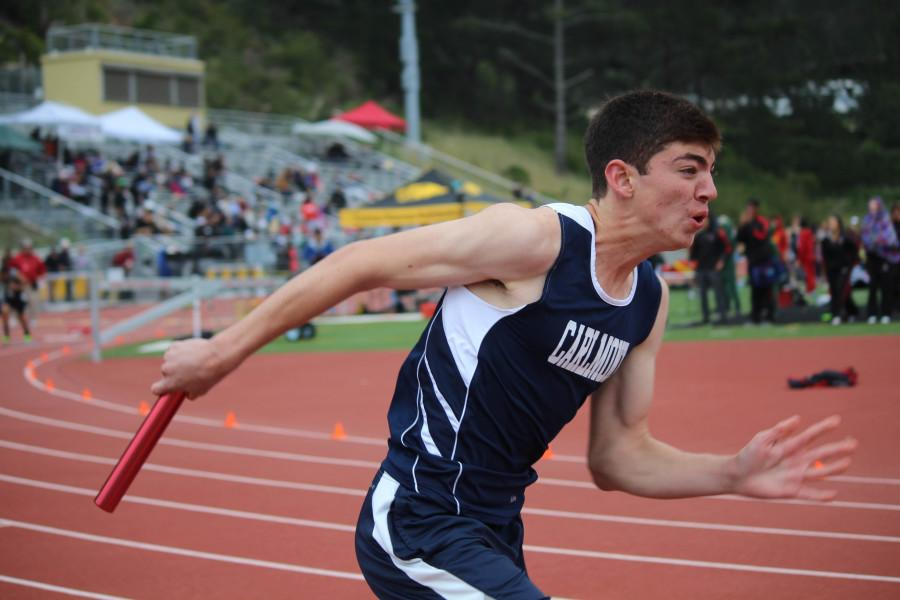 Sophomore Noah Shamsai strains every muscle in his body to propel himself through his lane in order to pass the baton to his teammate.