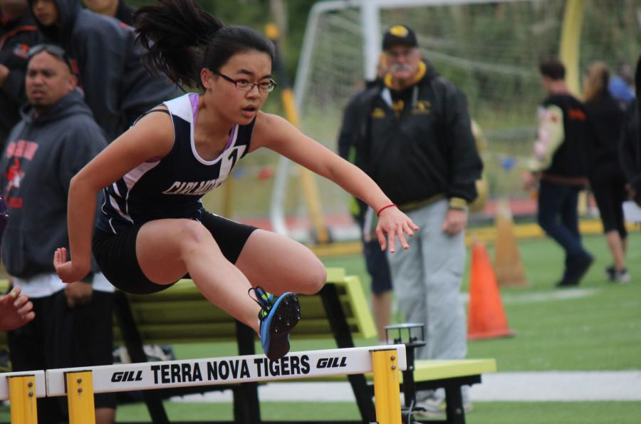 Freshman+Celine+Yang+leaps+into+the+air+as+she+glides+over+each+hurdle+in+a+synchronized+pattern
