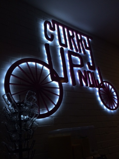 The interior of the restaurant matches the modern vibe given off by Curry Up Now's logo.
