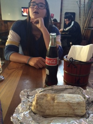 The paneer tikka masala burrito and a Coke make for a wonderful meal combination.