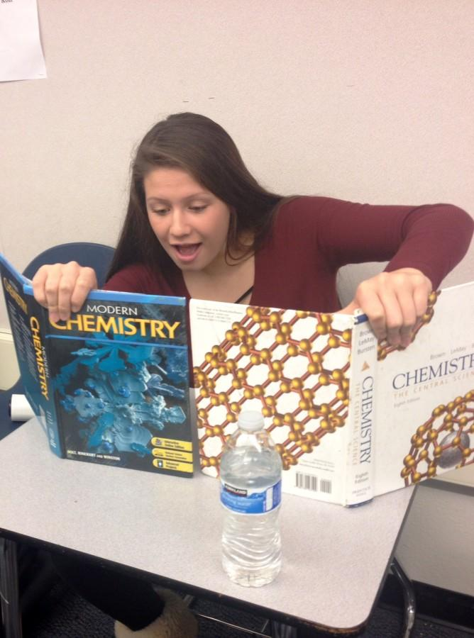Sophomore Anya Meredith displays excellent cramming technique by reading two chemistry textbooks at once.