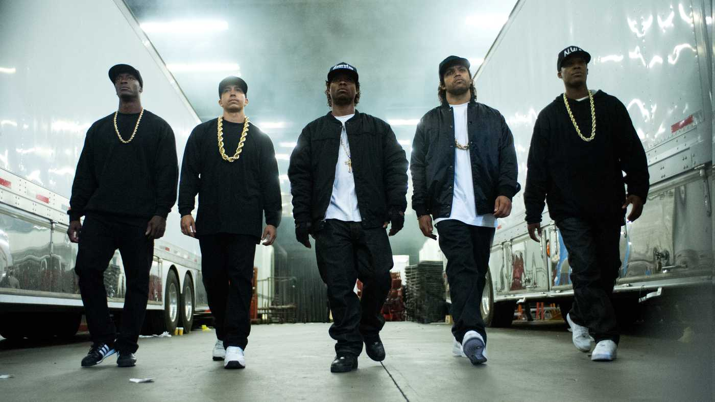 MC Ren (Aldis Hodge), DJ Yella (Neil Brown, Jr.), Eazy-E (Jason Mitchell), Ice Cube (O'Shea Jackson Jr.), and Dr. Dre (Corey Hawkins) form the hip hop group N.W.A in Straight Outta Compton