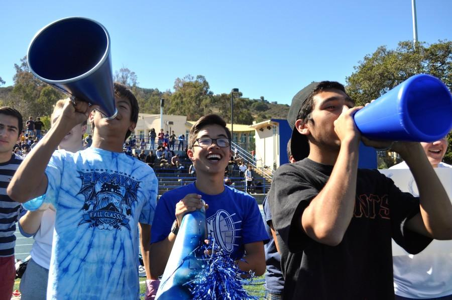 The Screamin' Scots show their pride for Carlmont by cheering for their football team.