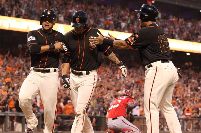 Giants teammates celebrate scoring after third baseman Matt Duffy's double on August 15, 2015.