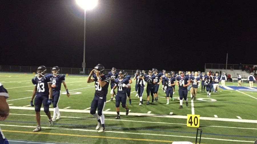 The Carlmont Scots exit the field after their hard fought game against the  Aragon Dons.