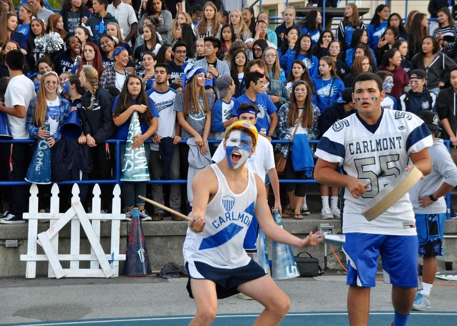 ASB+Vice+President+Lucas+Kelly+and+Senior+Vice+President+Sam+Levy+lead+the+crowd+to+cheer+for+their+team.+