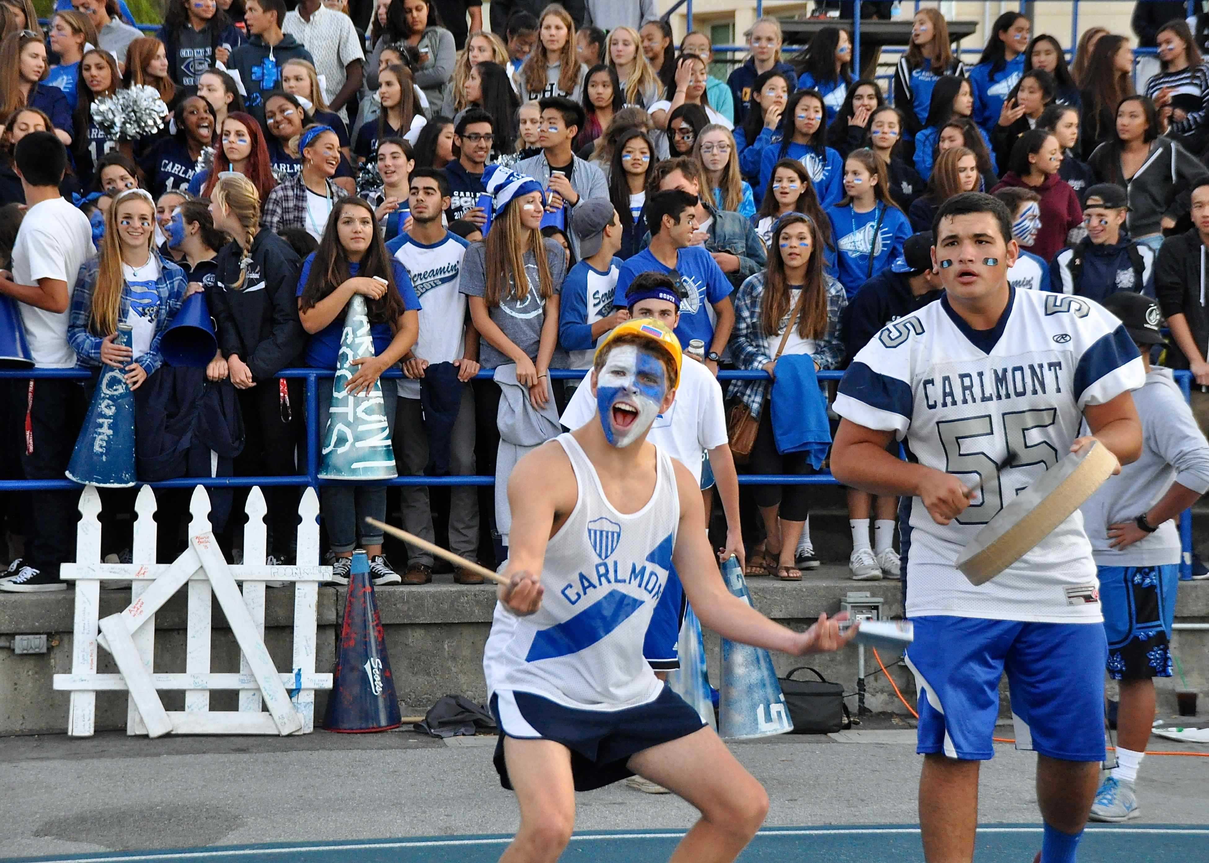 ASB Vice President Lucas Kelly and Senior Vice President Sam Levy lead the crowd to cheer for their team.