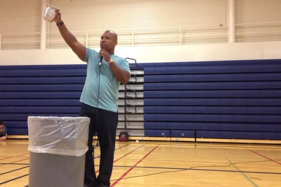 Hawkins uses a cup of water to create an analogy of a person's confidence that lowers when he or she is not supported by his or her peers.