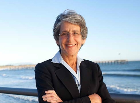 Hannah-Beth Jackson, the senator who brought about the California Fair Pay Act, poses in front of an ocean view.