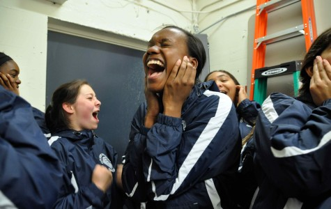 Senior and birthday girl Alexis Morrow leads the team through their pre-game scream tradition.