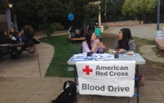 Do Something commissioners junior Anya Meredith and sophomore Katie Wong hold lunchtime sign ups for the Blood Drive.