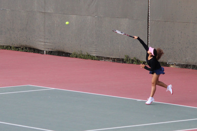 Carlmont senior Mar Burgueno serves the ball in her match.