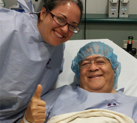 Carlmont teacher Cynthia Faupusa and her father, Nelson Artiga, rest before the surgery.