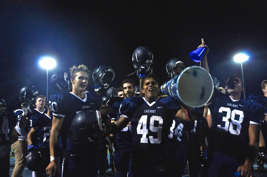 Despite their 21-14 loss against Jefferson, the Carlmont varsity football team sings the hymn in good spirits.