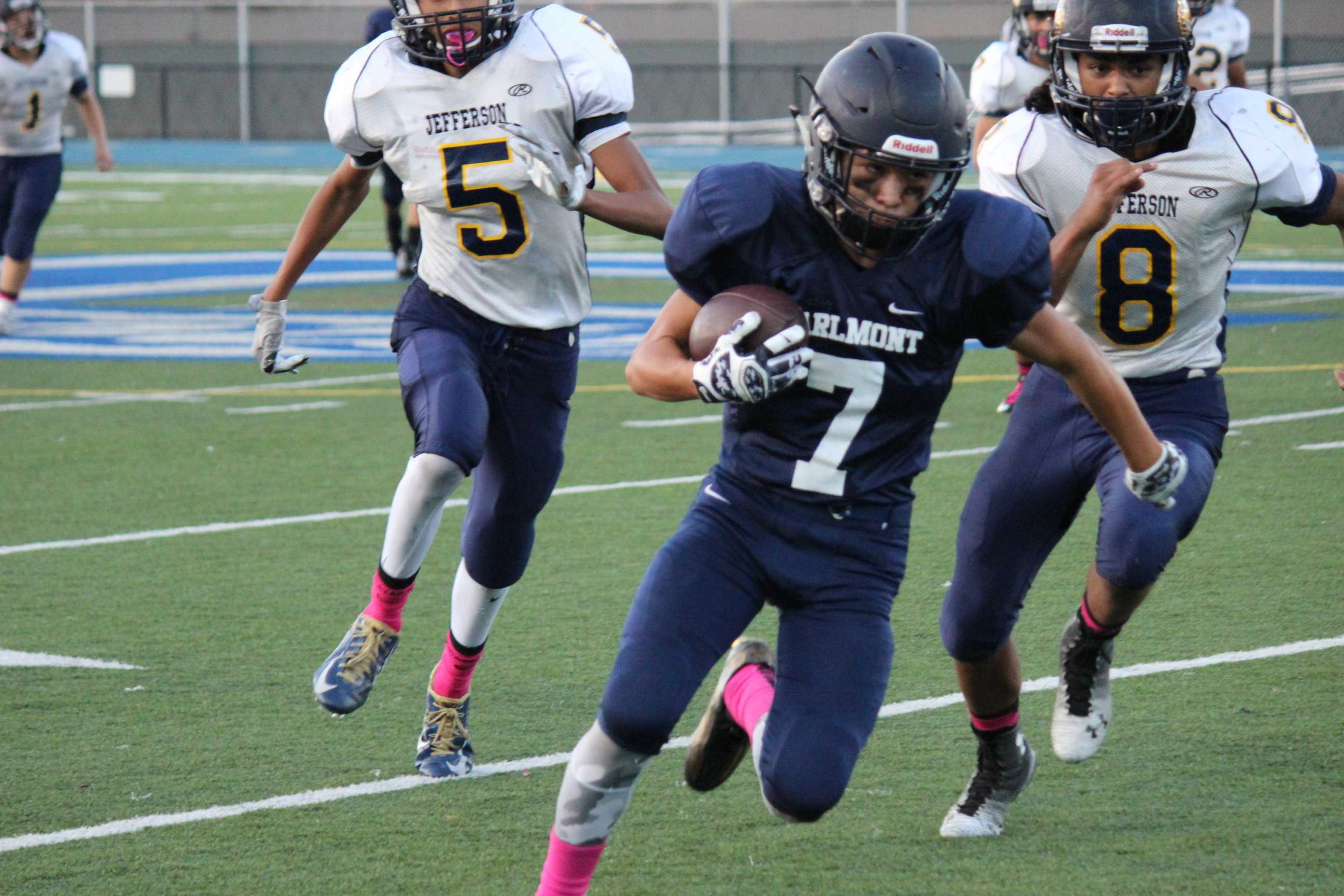 Sophomore Anthony Arteaga (7) runs down the side line at Carlmont in the fourth quarter.