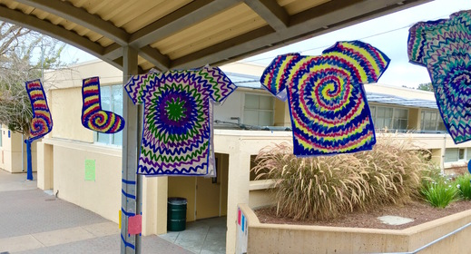 Posters for Tie-Dye Wednesday hang on the first day of Spirit Week.