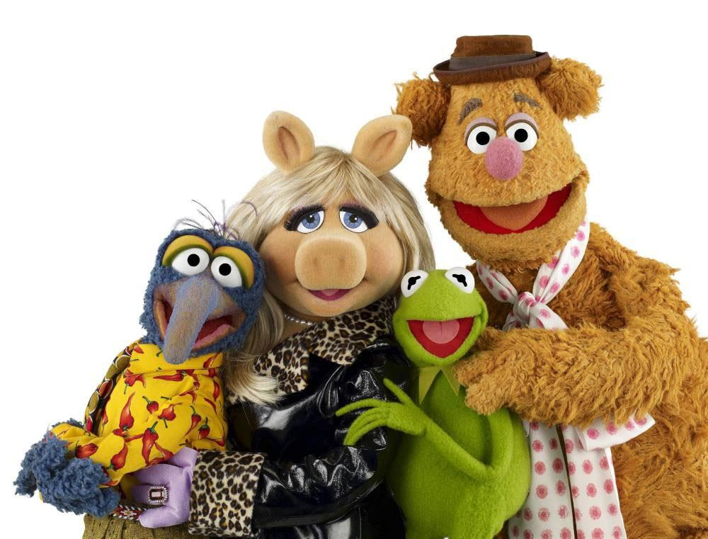 The ne'er-forgotten cast of Muppets pose for a promotional photo.