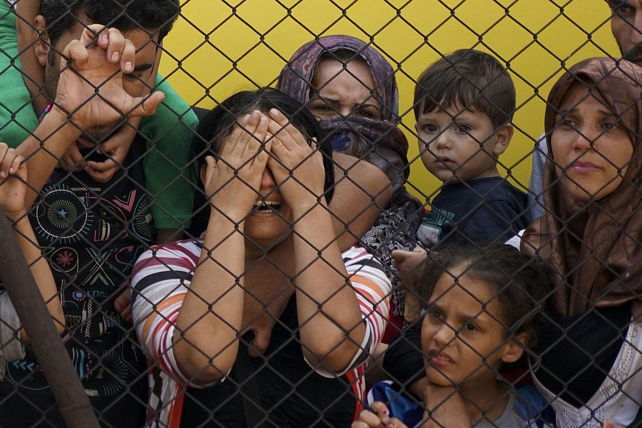 Syrian refugees wait at the platform of the Budapest Keleti railway station.