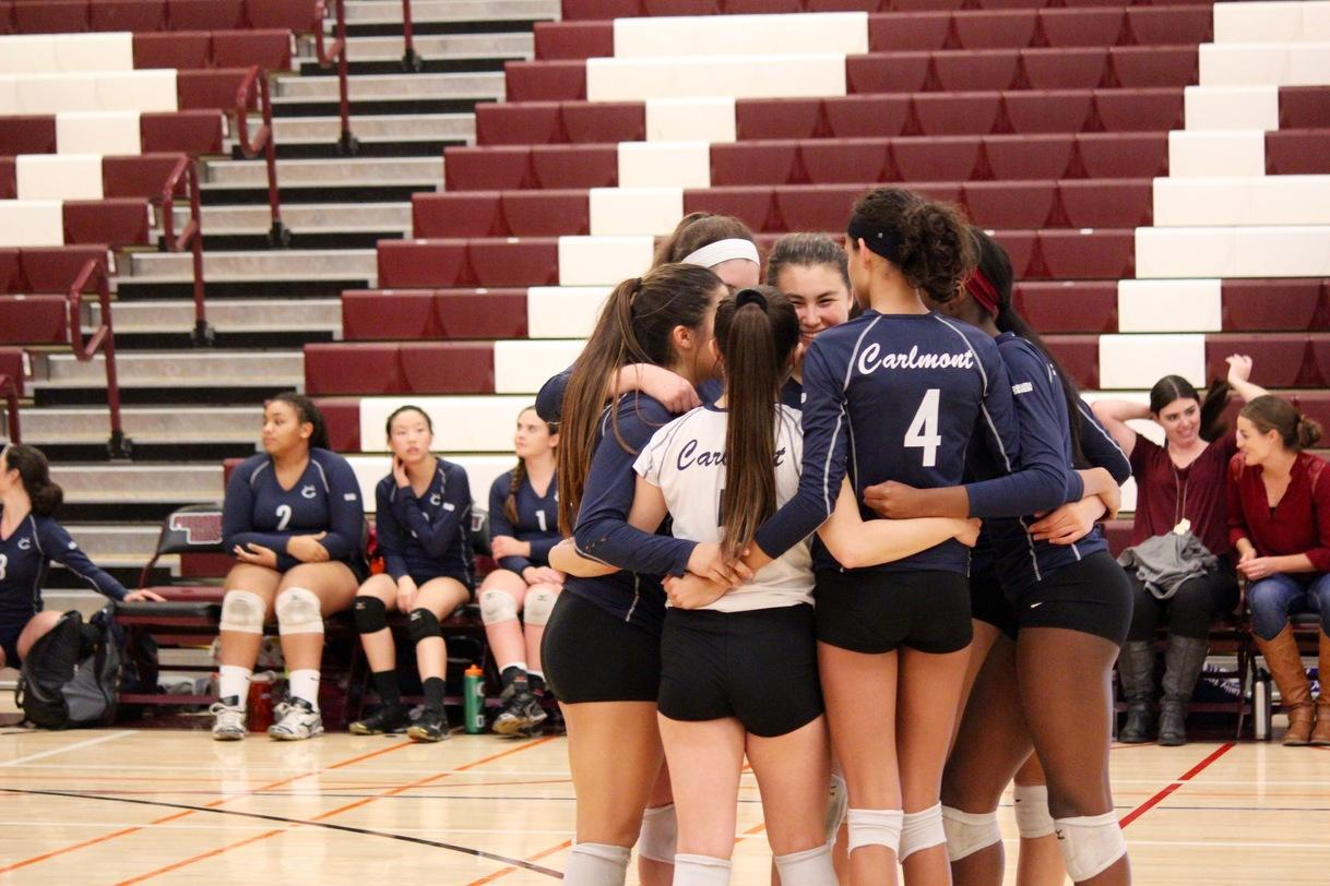 The players huddle on the court before the first game starts against Los Altos High School.