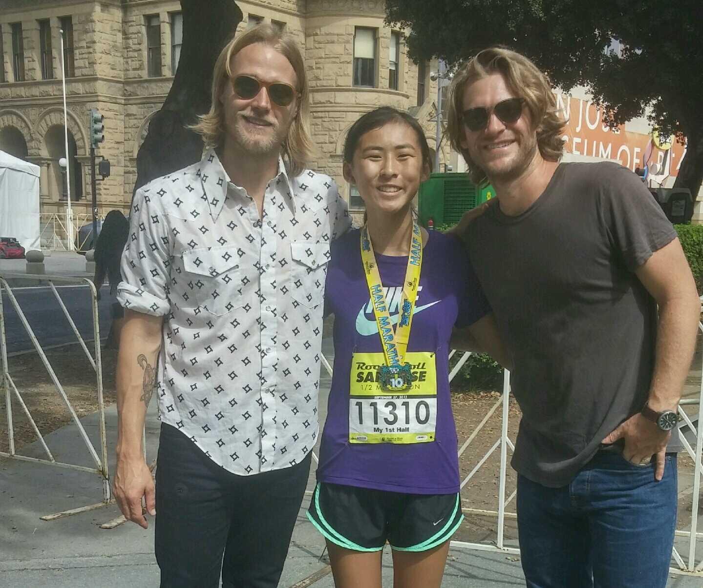 "During Thanksgiving break, many people do things they wouldn't be able to do during school. Sophomore Miya Okumura (center), finishes the San Jose Rock n' Roll half-marathon and takes a photo with rock duo Jamestown Revival. ""I ran the first nine miles, walked the rest, and afterward, I got a frappucino,"" said Okumura, laughing."