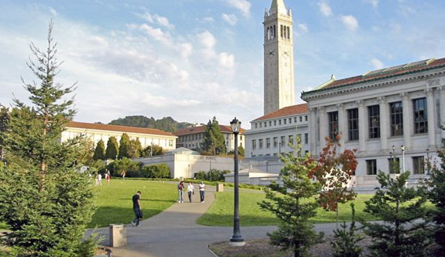 People take a walk outside on a clear day at UC Berkeley