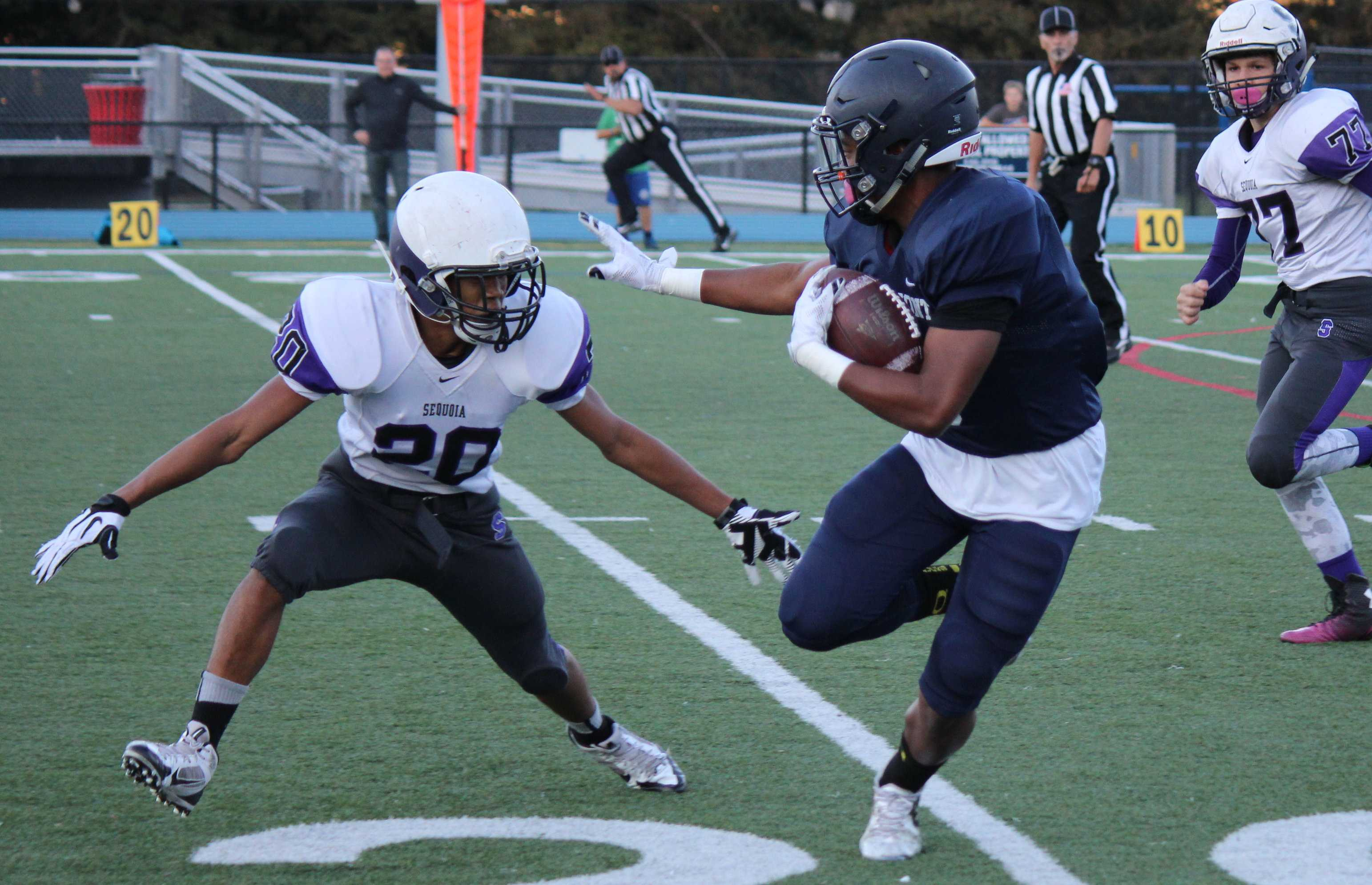 Sophomore Demarii Blanks (5) holds out a hand to push off an oncoming defender.