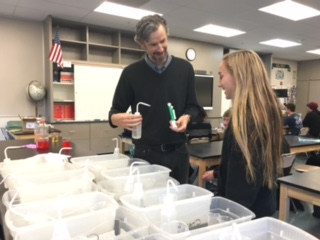 Sophomore Cassidy O'Connell and chemistry teacher Josh Engberg communicate lab expectations.