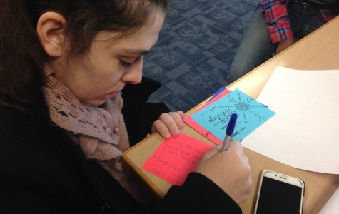 Senior Annie Klups takes advantage of free class time to write out thoughtful holiday grams for her friends.