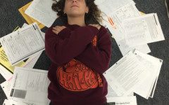 Carlmont student Michelle Tenin lays surrounded by her schoolwork.